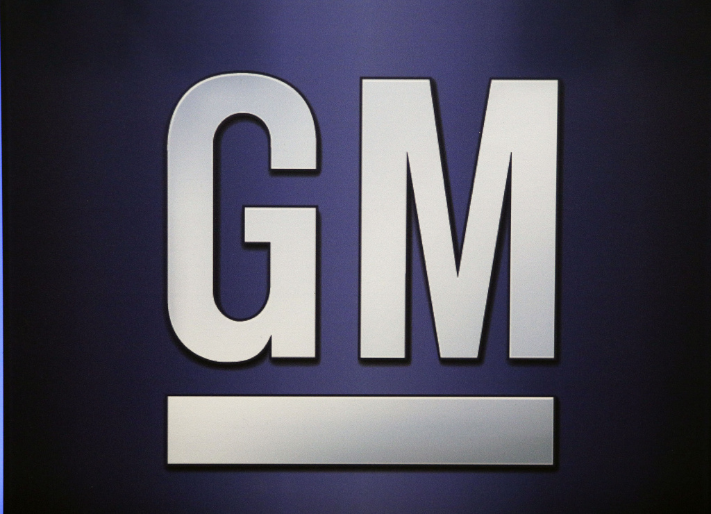 The General Motors logo is shown on the podium at the company's annual meeting of shareholders  June 6, 2017 in Detroit, Michigan. It recently bought a Pasadena firm for its autonomous car research.