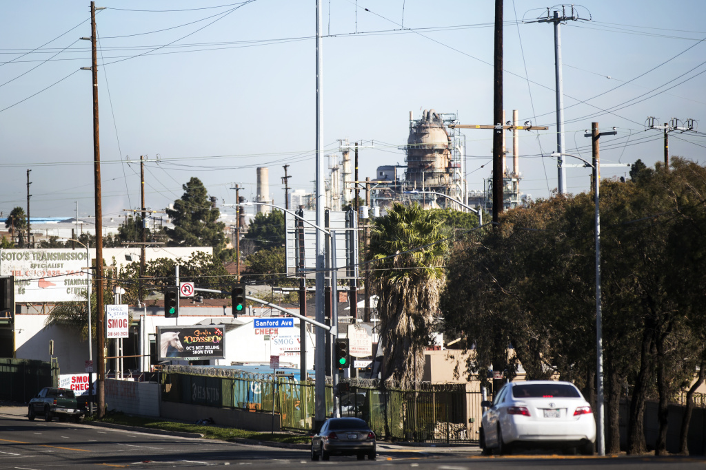 A refinery seen from the Pacific Coast Highway at Sanford Avenue in Wilmington, CA. Many environmental justice organizations oppose AB 398, the bill to extend cap and trade through 2031, while mainstream environmental groups say it's the most economical way to deepen the state's commitment to fighting climate change.