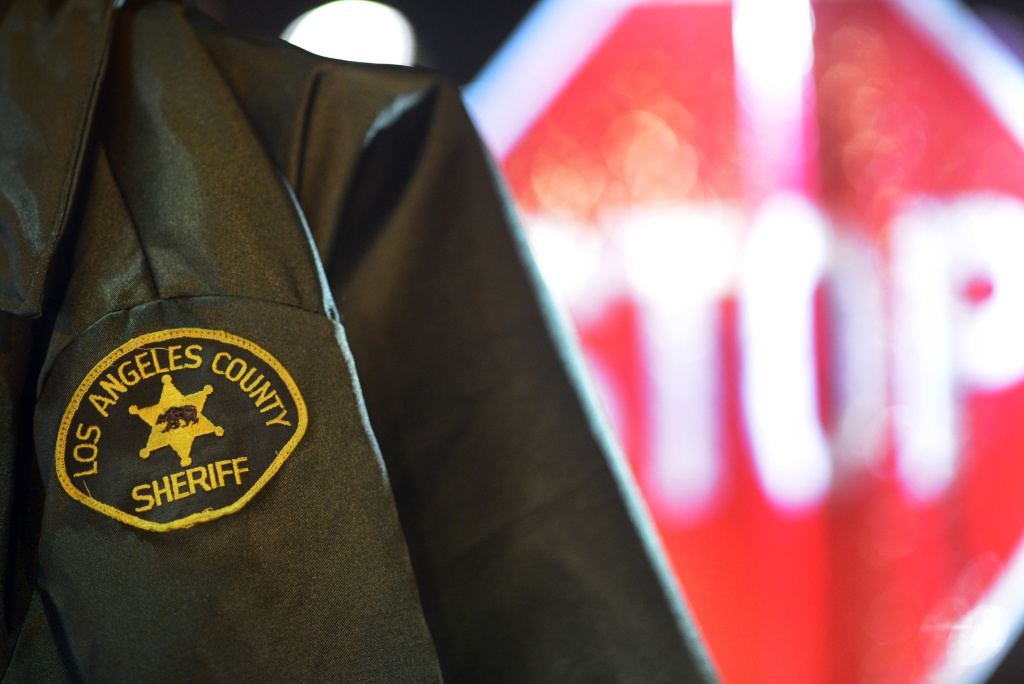 File: A Los Angeles Sheriff's Department deputy's jacket hangs near a stop sign at a DUI checkpoint in Bellflower Thursday evening near the intersection of Woodruff Avenue and Alondra Boulevard.
