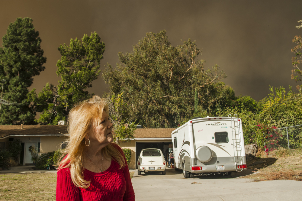 Cindy Speir watches for flames near the edge of the Creek Fire in Lakeview Terrace on Dec. 5, 2017.