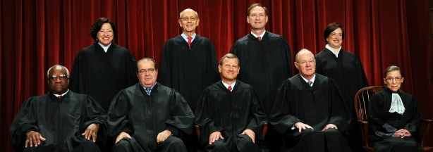 The Justices of the US Supreme Court sit for their official photograph on October 8, 2010 at the Supreme Court in Washington, DC. Front row: Associate Justice Clarence Thomas, Associate Justice Antonin Scalia, Chief Justice John G. Roberts, Associate Justice Anthony M. Kennedy and Associate Justice Ruth Bader Ginsburg. Back Row: Associate Justice Sonia Sotomayor, Associate Justice Stephen Breyer, Associate Justice Samuel Alito Jr. and Associate Justice Elena Kagan.