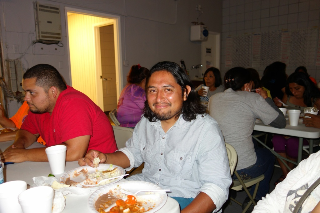 Canvasser Miguel Morales shares dinner with fellow campaign workers at a campaign field office paid for by an independent group supporting mayoral candidate Eric Garcetti.