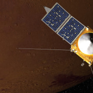 Artist concept of MAVEN spacecraft in orbit around Mars.