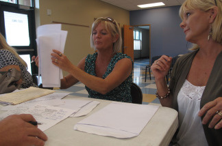 Twin sisters Sheila Newman (left) and Sheryl Lindsay of Orange Beach, Ala., make their case to a BP claims adjuster. The wedding planners have been trying since June to get BP to pay for lost income from the oil spill.