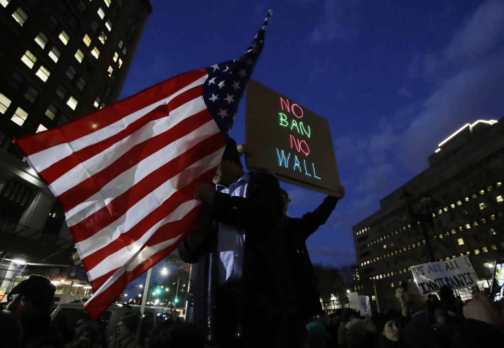 Protestors gather at Brooklyn Borough Hall to pray before a rally in protest President Donald Trump's immigration order Thursday, Feb. 2, 2017, in New York. (AP Photo/Frank Franklin II)
