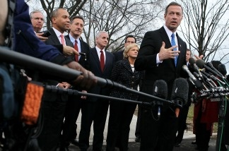 Governor Martin O'Malley of Maryland (center) speaks as other Democratic governors look on during a press briefing after a meeting with President Barack Obama on Feb. 25, 2011 in Washington, DC.