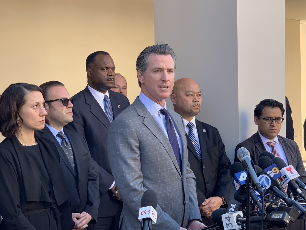 Governor Gavin Newsom speaks in Long Beach after meeting with mayors across the state who are not compliant with state housing plans laws.