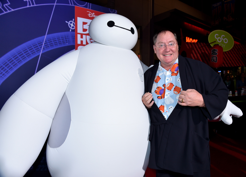 "Chief Creative Officer at Pixar, Walt Disney Animation Studios and DisneyToon Studios John Lasseter (R) with character Baymax attends the Los Angeles Premiere of Walt Disney Animation Studios' ""Big Hero 6"