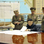 "North Korean leader Kim Jong Un with top brass in a photo released by the state-run KCNA. The chart in the background reportedly reads ""U.S. mainland strike plan""."