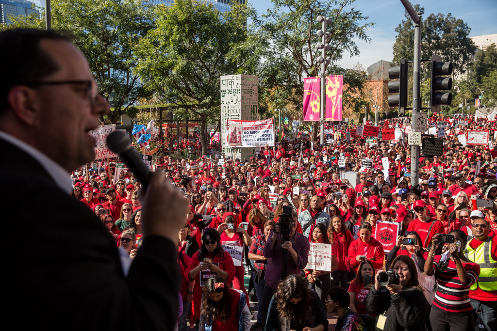 United Teachers of Los Angeles president Alex Caputo-Pearl speaks to a crowd of striking teachers in Grand Park on January 22, 2019 in downtown Los Angeles, California. Thousands of striking teachers, educators, students, parents, and supporters cheered for victory at a massive rally after it was announced that a tentative deal between the United Teachers of Los Angeles union and the Los Angeles Unified School District heavily favored educators' demands including a cap on rising class sizes, funding for school nurses, and a significant pay increase.