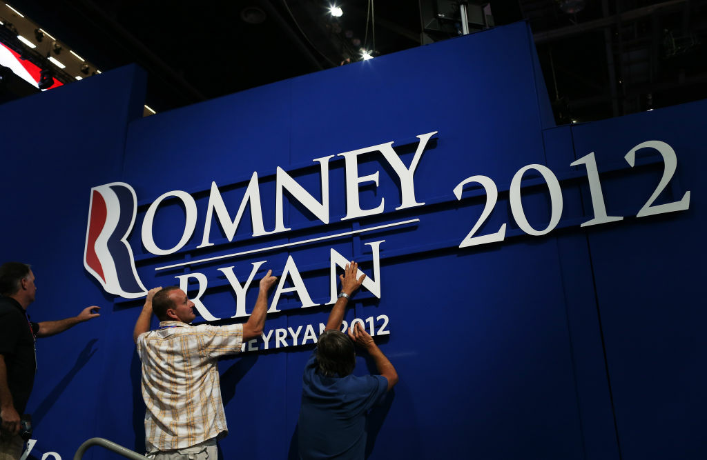 Workers hang a sign ahead of the Republican National Convention at the Tampa Bay Times Forum on August 26, 2012 in Tampa, Florida.