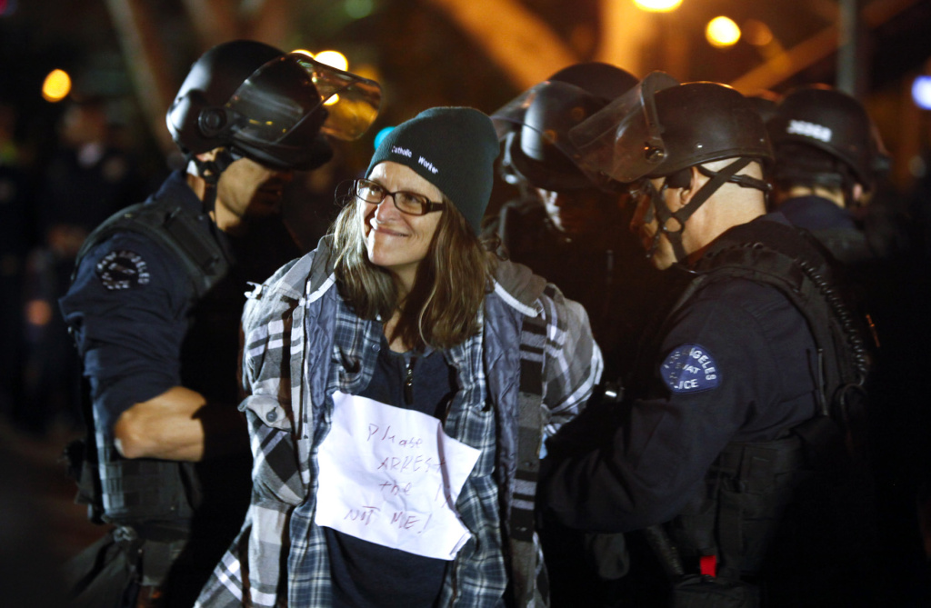 An Occupy Los Angeles protester is arrested by Los Angeles Police Department officers after LAPD raided the protest campsite in the early hours of November 30, 2011 in Los Angeles, California.