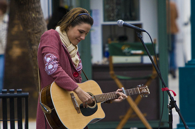 Street musician Chelsea Williams plays her guitar at the Third Street Promenade in Santa Monica.