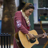Street musician Chelsea Williams plays her guitar at the Third Street Promenade in Santa Monica.