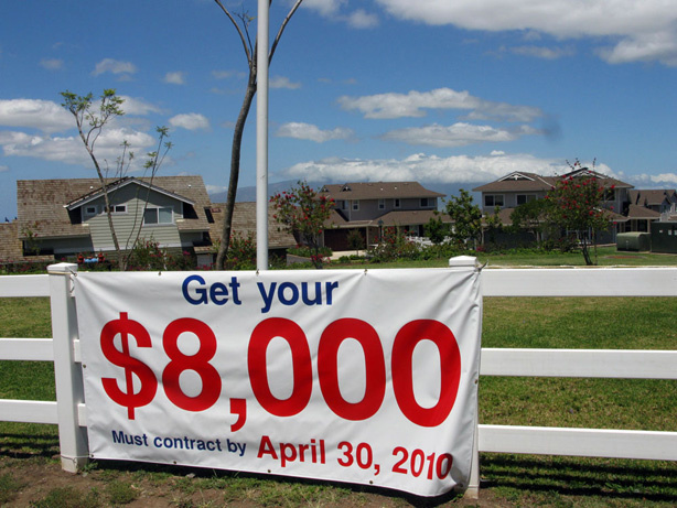 A sign in Maui, Hawaii, urges people to buy before the $8,000 tax credit expires. Both individuals and businesses can get credits.