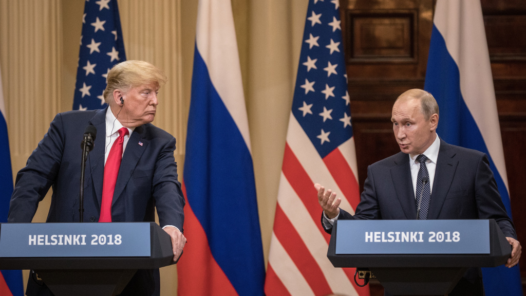 President Trump and Russian President Vladimir Putin answer questions during a joint press conference after their summit on July 16 in Helsinki.