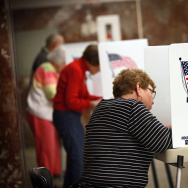 WATERLOO, IA - SEPTEMBER 27:  Residents fill in their ballots during early voting at the Black Hawk County Courthouse on September 27, 2012 in Waterloo, Iowa. Early voting starts today in Iowa where in the 2008 election 36 percent of voters cast an early ballot.  (Photo by Scott Olson/Getty Images)