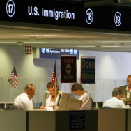 U.S. Immigration  inspectors check passports July 2, 2002 at Miami International Airport in Miami, Florida.