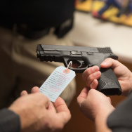 BRIDGETON, MO - NOVEMBER 12:  Customers shop for a handgun at Metro Shooting Supplies on November 12, 2014 in Bridgeton, Missouri.