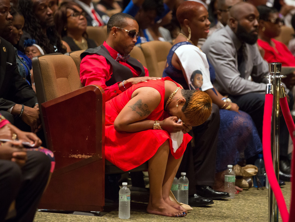 ST. LOUIS, MO - AUGUST 25:  Lesley McSpadden cries during the funeral services for her son Michael Brown inside Friendly Temple Missionary Baptist Church on August 25, 2014 in St. Louis Missouri. Michael Brown, an 18 year-old unarmed teenager, was shot and killed by  Ferguson Police Officer Darren Wilson in the nearby town of Ferguson, Missouri on August 9. His death caused several days of violent protests along with rioting and looting in Ferguson.  (Photo by Richard Perry-Pool/Getty Images)