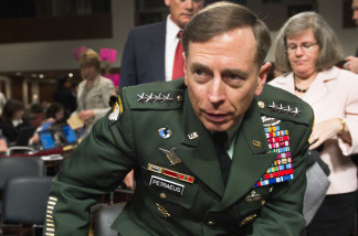 Gen. David Petraeus testifies before the Senate Armed Services Committee on Tuesday. The Senate confirmed him as President Obama's choice to take control of forces in Afghanistan.