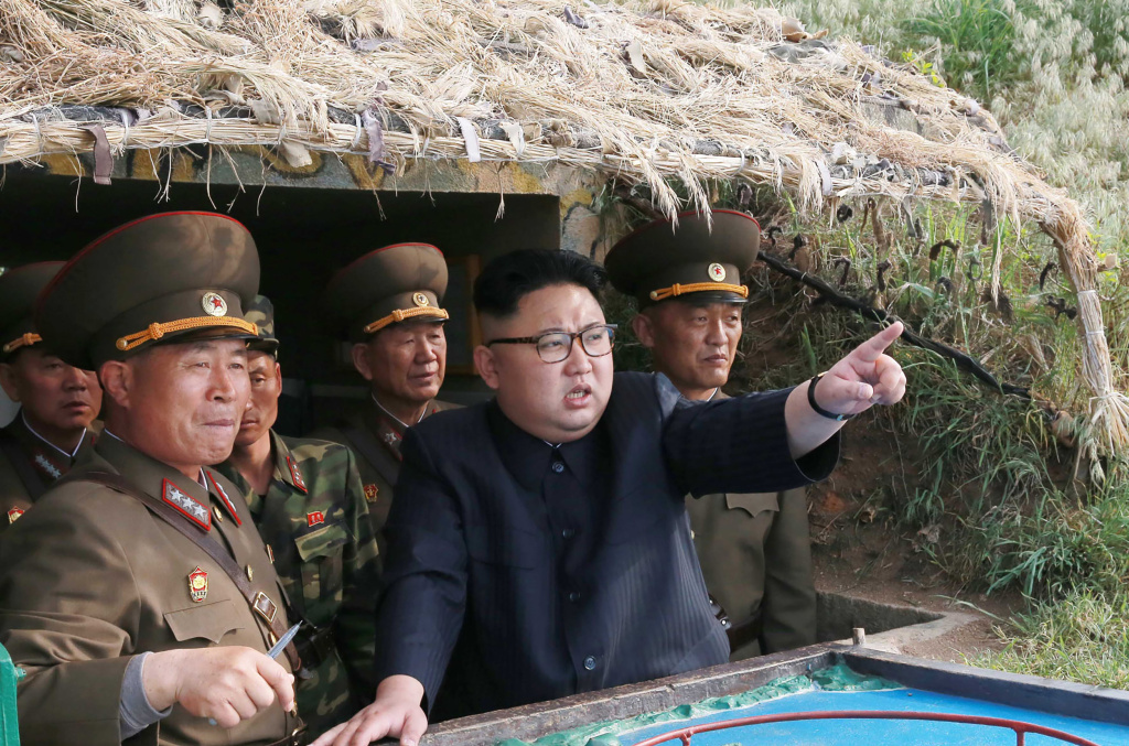 North Korean leader Kim Jong Un (center), inspecting a defense detachment on Jangjae Islet and the Hero Defence Detachment on Mu Islet in a photo published by state media.