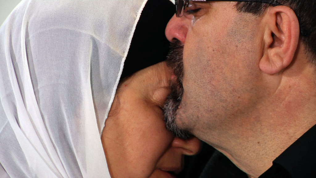 """Namee Barakat hugs a female relative during a news conference in Raleigh, N.C., about the death of his son, Deah, his daughter-in-law and her sister on Wednesday, Feb. 11, 2015. Barakat said the death penalty """"would not be enough"""" for Craig Hicks, the man charged with murdering the three Muslim students. (AP Photo/Allen G. Breed)"""