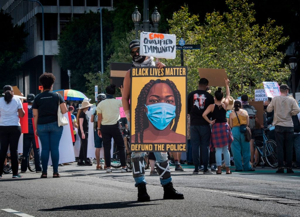 People protest against the death of George Floyd and others in police custody, as they support the Black Lives Matter movement outside the Hall of Justice in Los Angeles, California on June 24, 2020.