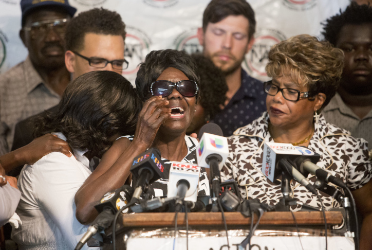 Pamela Benge, center, spoke of her son, Alfred Olango, at a press conference on Thursday Sept. 29, 2016, in San Diego, Calif., to address the killing of Olango, a Ugandan refugee shot by an El Cajon police officer on Tuesday. In an emotional appearance before reporters, Benge said  her son Alfred was joyful and loving and was not mentally ill.