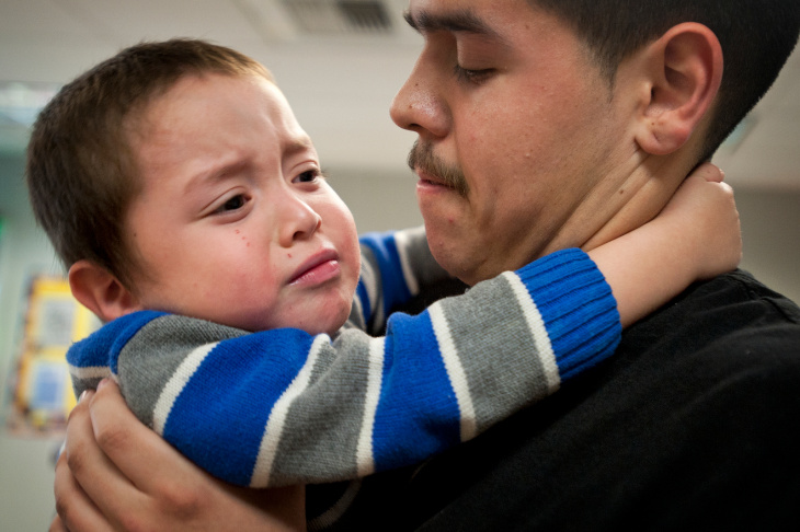 Roger Razo, 18, and his two-year-old son, Andrew, say goodbye after spending time at his daycare at North Park High School in Baldwin Hills on Friday, March 8. The childcare services are through Baldwin Park school district's Early Childhood programs.