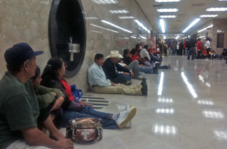 Farm workers await California Governor Jerry Brown's decision on card check. The governor vetoed it shortly before midnight, June 28, 2011.