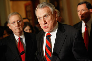 Senate Minority Whip Jon Kyl (R-AZ) (C) makes brief remarks to the press with Senate Minority Leader Mitch McConnell (R-KY) (L) and Sen. John Barrasso (R-WY) after the weekly Senate Republican Policy Luncheon in the U.S. Capitol January 25, 2011 in Washington, DC.