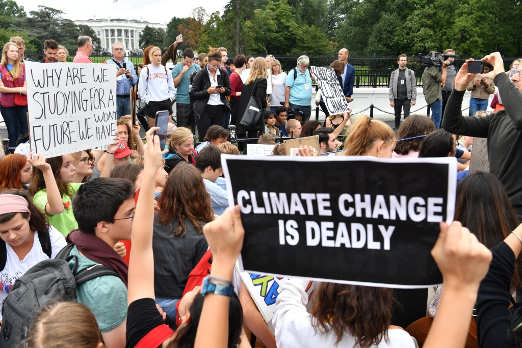 Teenagers and students take part in a climate protest outside the White House (background) in Washington on September 13, 2019.
