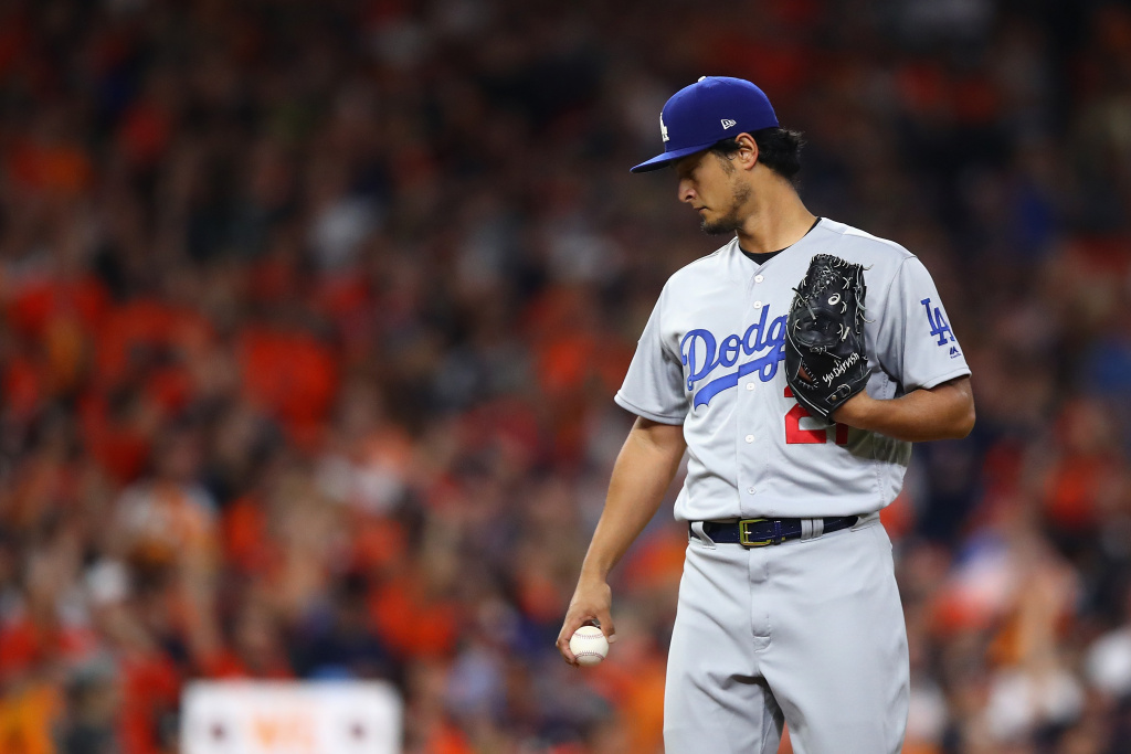 Pitcher Yu Darvish (#21) of the Los Angeles Dodgers looks on after giving up a solo home run to Yuli Gurriel (#10) of the Houston Astros during Game 3 of the 2017 World Series on October 27, 2017 in Houston, Texas.