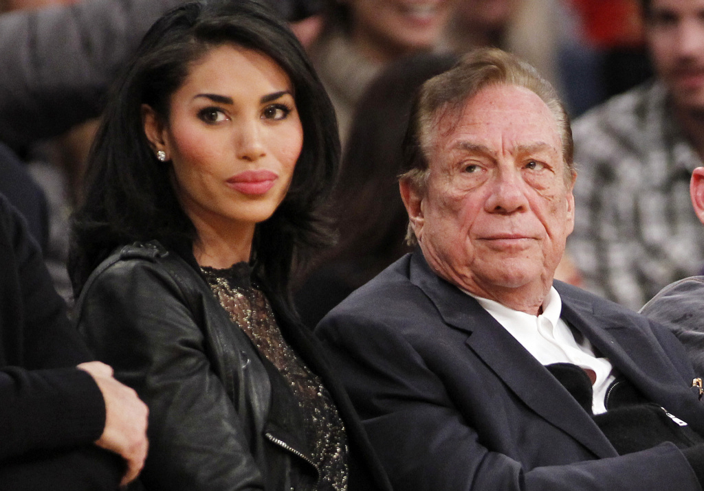 In this Dec. 19, 2010, file photo, Los Angeles Clippers owner Donald Sterling, right, and V. Stiviano, left, watch the Clippers play the Los Angeles Lakers during an NBA preseason basketball game in Los Angeles. A civil trial has put the Sterling, his estranged wife and Stiviano in the same room about a year after the recording of Donald Sterling telling Stiviano not to publicly associate with blacks culminated with his lifetime ban from the NBA and the record $2 billion sale of the team.