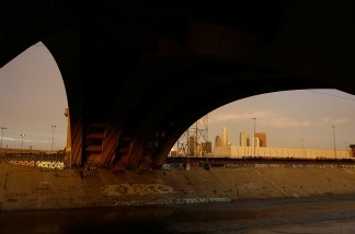 The 4th Street Bridge spans the Los Angeles River at sunrise.