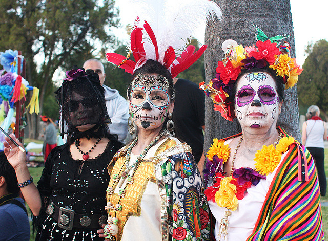 Women pose for a picture during Dia de los Muertos at the Hollywood Forever Cemetery in 2011.