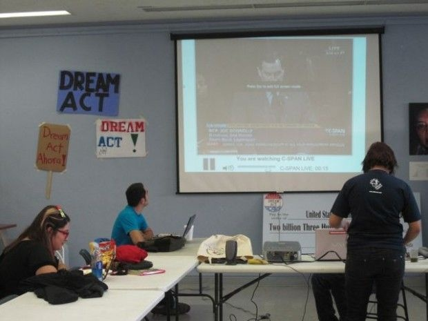 Students at a makeshift call center downtown watch C-SPAN as they make final calls to legislators urging support for the Dream Act, December 8, 2010