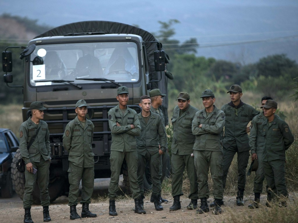 Soldiers stand at the entrance of the Tienditas International bridge that connects Venezuela with Colombia.