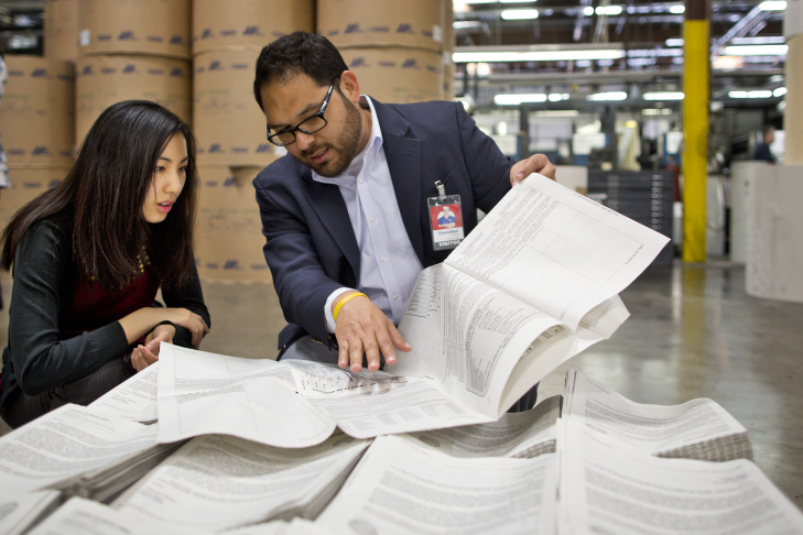 Regina Ip, left, and Efrain Escobedo of the Los Angeles County Registrar/Recorder-Clerk look through election ballots inside Merrill Corporation's La Mirada facility on Tuesday, April 22.