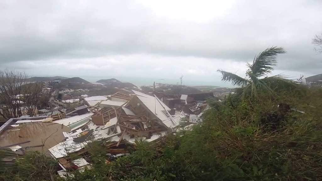 This image made from video shows several damaged houses by Hurricane Irma in St. Thomas, U.S. Virgin Islands, on Thursday.