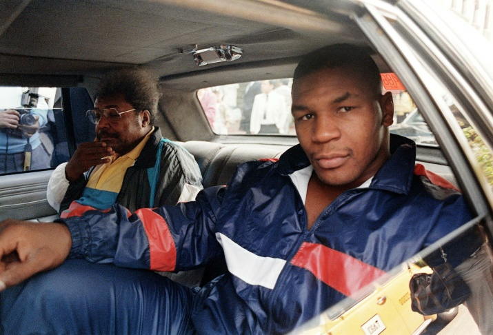 Heavyweight champion Mike Tyson (R) and