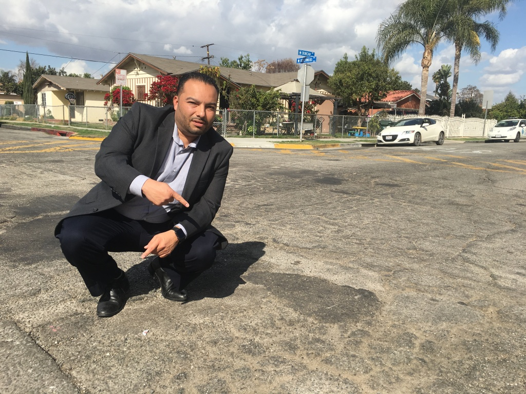Lynwood Mayor Jose Luis Salache on deteriorated Duncan Avenue whose repair is accelerated with money from SB1, California's new gas tax.