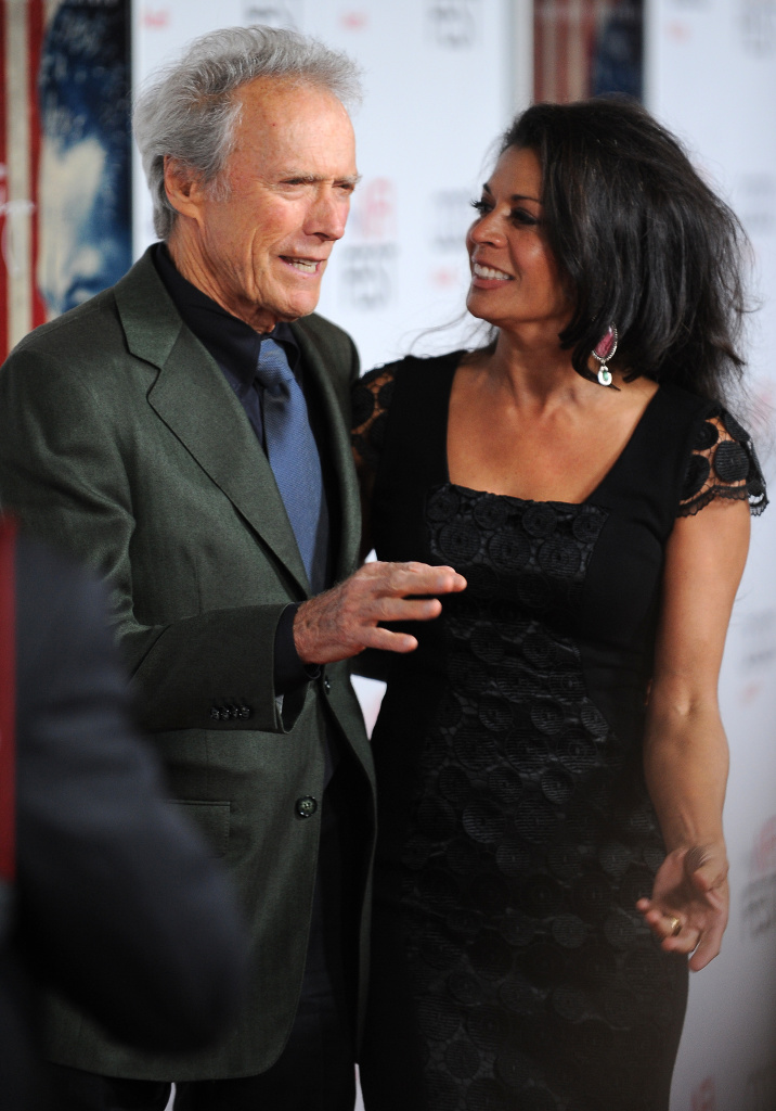 Director Clint Eastwood arrives with his wife Dina Eastwood at the world premiere of