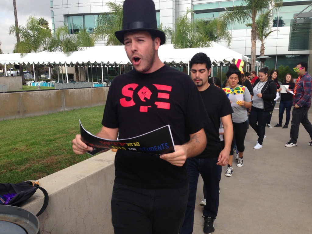 Students protest college fees outside a meeting of the California State University trustees in Long Beach on Thursday.