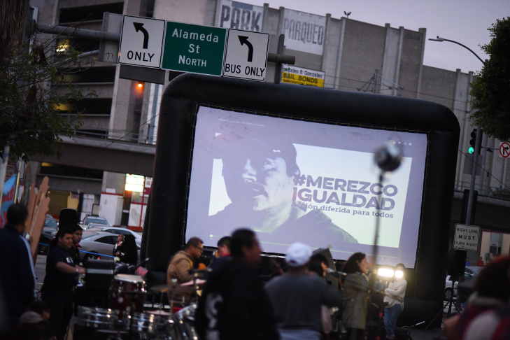 Dulce Saavedra, right, hugs Miriam Lopez, right, after a speech by President Obama reforming immigration policy was aired live on a projector screen in downtown Los Angeles Thursday.   President Obama addresses the nation with reforms in immigration policy in downtown Los Angeles on Thursday Nov. 20, 2014.
