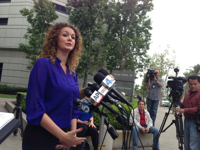 Orange County District Attorney's office spokeswoman Farrah Emami talks to reporters about rape, lewd acts on a minor charges against Isidro Garcia on Thursday, May 22, 2014.