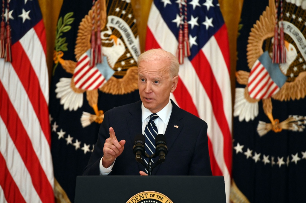 President Biden tells reporters Thursday during his first press briefing that he expects to run for reelection but that he is a