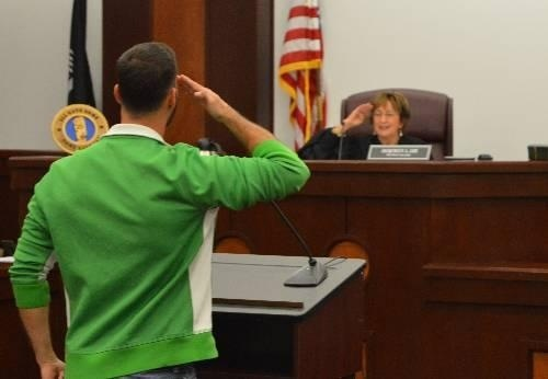 A veteran salutes Judge Jacqueline L. Lee in the Harnett County, N.C. Veterans Treatment Court.