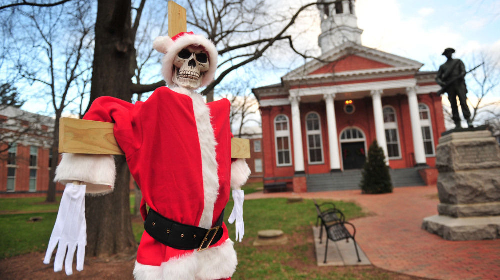 A skeleton dressed in a Santa Claus costume is part of the holiday displays at the Loudoun County Courthouse in Leesburg, Va. Many local residents are not pleased with the